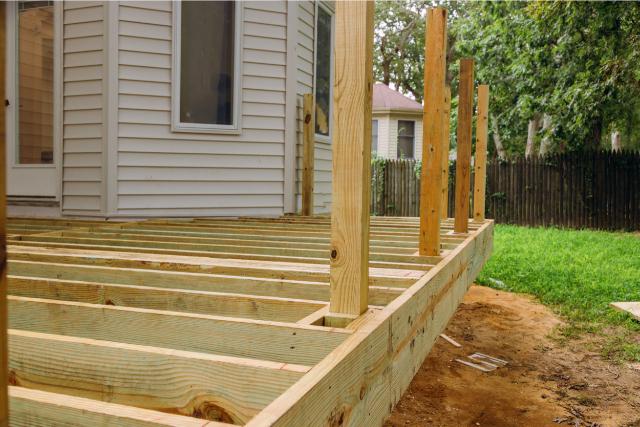 Deck Patio with Modern Wooden Deck being built